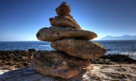 Stones_Piled_On_Beach_201404